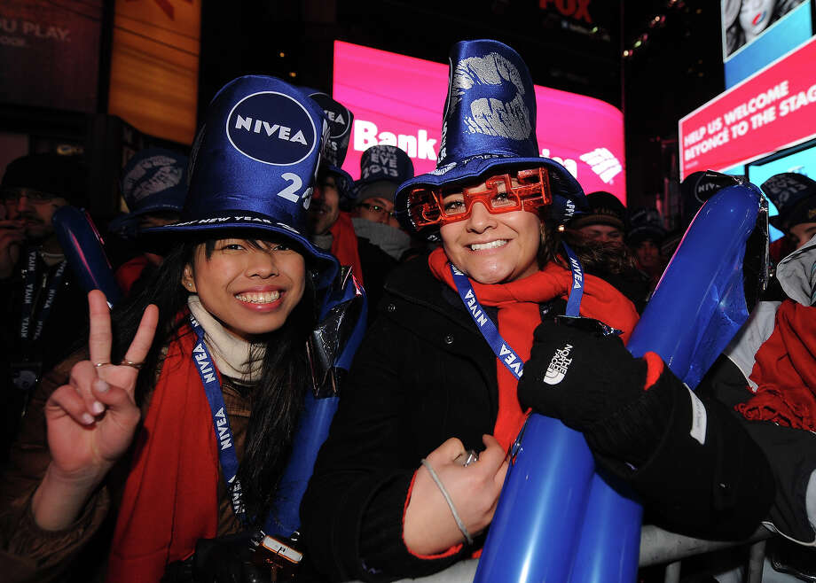 NEW YORK, NY - DECEMBER 31:  Revelers in Times Square on New Year's Eve get festive with NIVEA accessories and products at Times Square on December 31, 2012 in New York City. Photo: Brad Barket, Getty Images For NIVEA / 2012 Getty Images