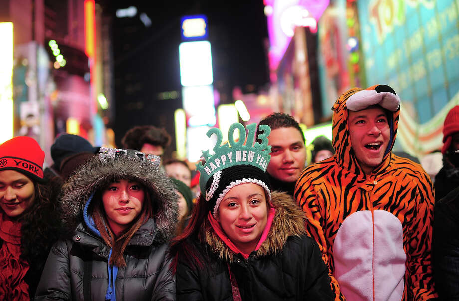 Revelers gather on Times Square during New Year's Eve celebrations  in New York, December, 31, 2012. AFP PHOTO/EMMANUEL DUNAND Photo: EMMANUEL DUNAND, AFP/Getty Images / 2013 AFP