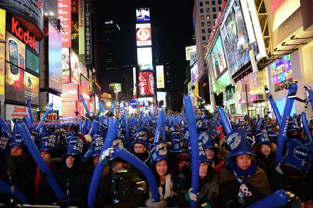 Revelers gather on Times Square on December 31, 2012 in New York City, where as many as a million people are expected to celebrate New Year's by viewing the traditional drop of a giant crystal ball -- and a billion more watching on TV around the world. Photo: EMMANUEL DUNAND, AFP/Getty Images / 2013 AFP