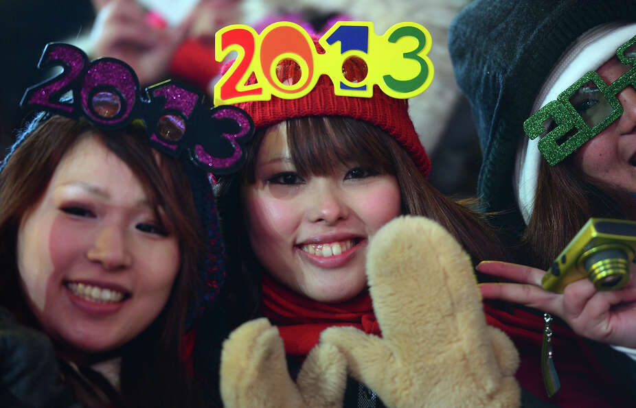 Revelers gather on Times Square on December 31, 2012 in New York City, where as many as a million pe