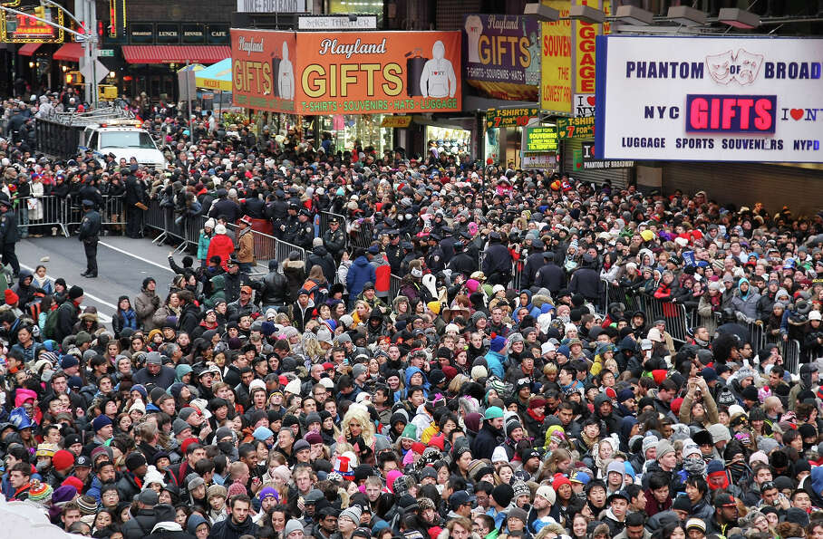 NEW YORK, NY - DECEMBER 31: Revelers gather in Times Square to celebrate New Year's Eve on December