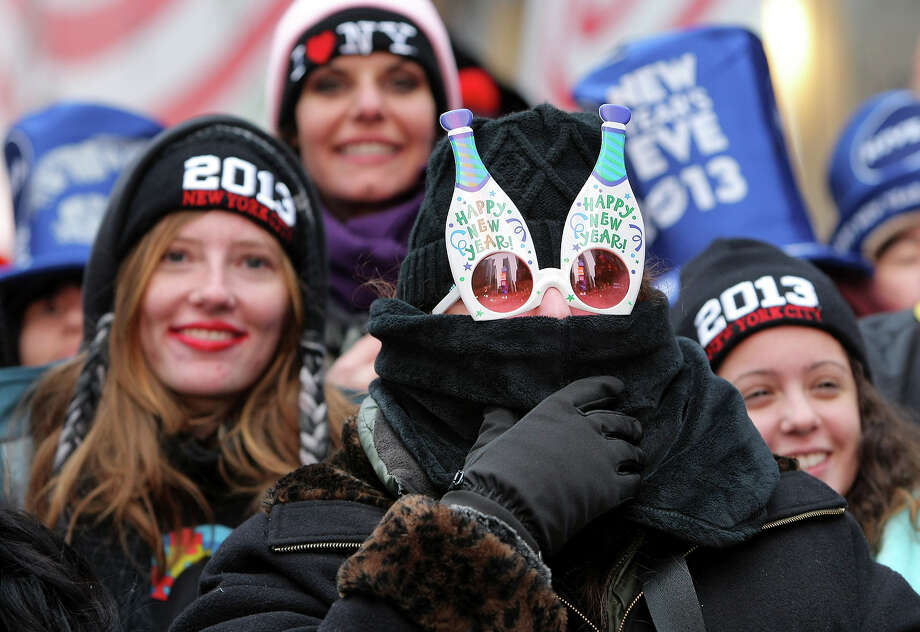 NEW YORK, NY - DECEMBER 31: Orly Tzour of Los Angeles wears festive sunglasses as she joins revelers to celebrate New Year's Eve in Times Square on December 31, 2012 in New York City. Approximately one million people are expected to ring in the new year in Times Square. Photo: Monika Graff, Getty Images / 2012 Getty Images