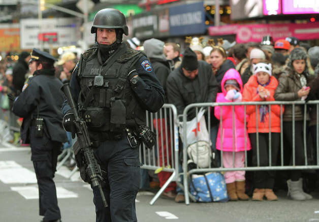 NEW YORK, NY - DECEMBER 31: New York City police officers keep an eye on the crowds as hundreds of thousands of revelers gather in Times Square to celebrate New Year's Eve on December 31, 2012 in New York City. Approximately one million people are expected to ring in the new year in Times Square. Photo: Monika Graff, Getty Images / 2012 Getty Images