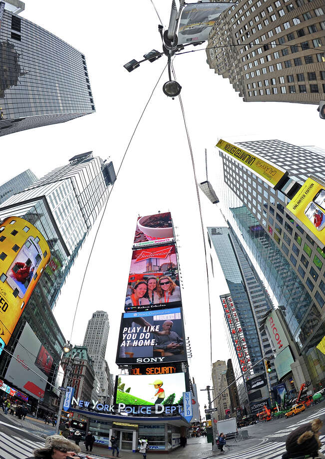 Buildings and billboards December 27, 2012 in New York's Times Square.  AFP PHOTO/Stan HONDA Photo: STAN HONDA, AFP/Getty Images / 2012 AFP