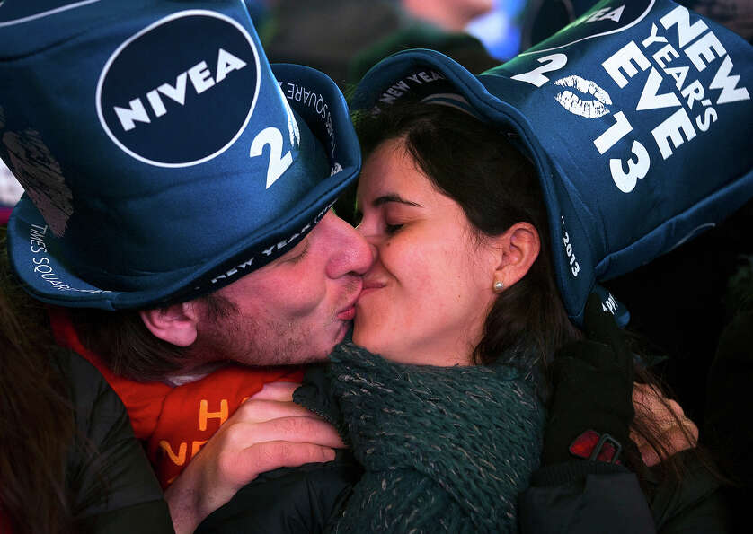 Simone Renes and Cristina Vanoli, of Italy, share a kiss in Times Square at the New Year's Eve celeb