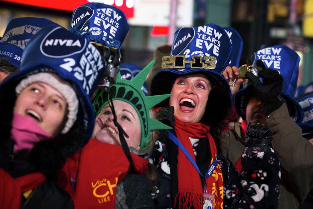 Olga Lovchu, of Chicago, center right, cheers in Times Square for the New Year's Eve celebration, Monday, Dec. 31, 2012, in New York. This will be the first Times Square countdown in decades without Dick Clark, who died in April, and will be honored with a tribute concert and his name printed on pieces of confetti. Photo: AP