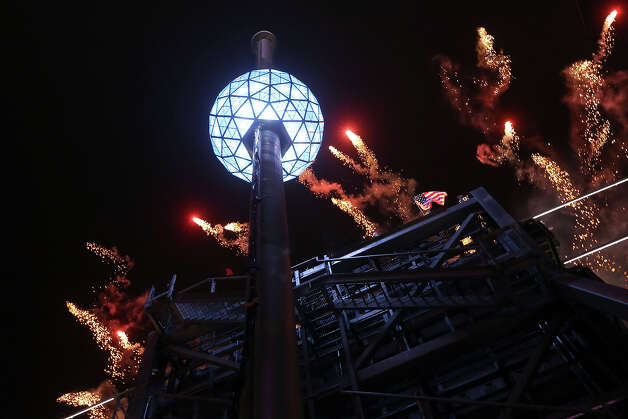 The fireworks explode as the Waterford crystal ball is raised at the beginning of Times Square New Year's celebration, Monday, Dec. 31, 2012 in New York. Photo: AP