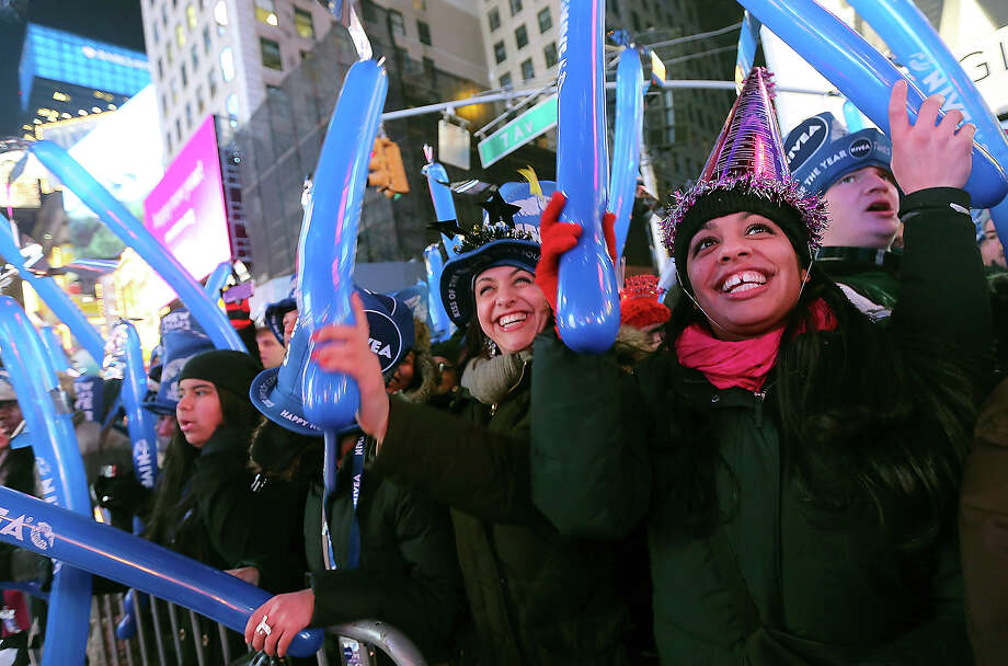 Jackie Soto, right, and Nicole Soto, of Cherry Hill, N.J. dance during one of the musical performances at the Times Square New Year's celebration Monday, Dec. 31, 2012 in New York. Photo: AP