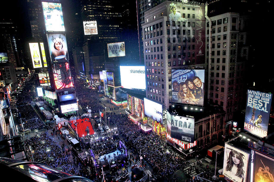 "FILE - In this Dec. 31, 2011 file photo, the crowd packs New York's Times Square during the New Year's Eve celebration as seen from the Marriott Marquis hotel. It's no small task making sure the annual celebration remains safe, but the New York City police use an array of security measures for the event that turns the ""Crossroads of the World"" into a massive street party in the heart of Manhattan. Photo: AP"