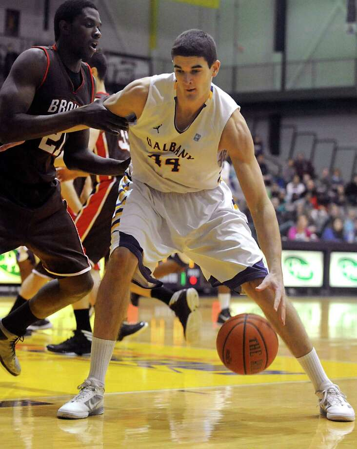 UAlbany's John Puk drives to the hoop during a basketball game against Brown at the SEFCU Arena on Monday Dec. 31, 2012 in Albany, N.Y. (Lori Van Buren / Times Union) Photo: Lori Van Buren