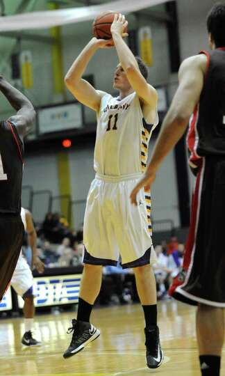 UAlbany's Luke Devlin sinks a jump shot during a basketball game against Brown at the SEFCU Arena on