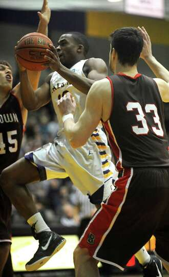 UAlbany's Mike Black drives to the hoop during a basketball game against Brown at the SEFCU Arena on