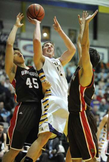 UAlbany's Luke Devlin is double teamed by Brown's Rafael Maia, left, and Joe Sharkey as he drives to