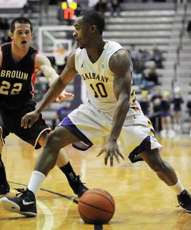 UAlbany's Mike Black dribbles the ball to the hoop while guarded by Brown's Sean McGonagill during a basketball game at the SEFCU Arena on Monday Dec. 31, 2012 in Albany, N.Y. (Lori Van Buren / Times Union) Photo: Lori Van Buren