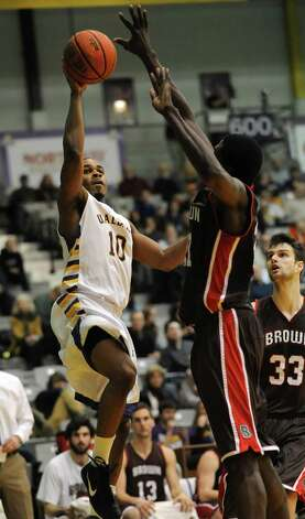 UAlbany's Mike Black drives to the hoop while guarded by Brown's Cedric Kuakumensah during a basketball game at the SEFCU Arena on Monday Dec. 31, 2012 in Albany, N.Y. (Lori Van Buren / Times Union) Photo: Lori Van Buren