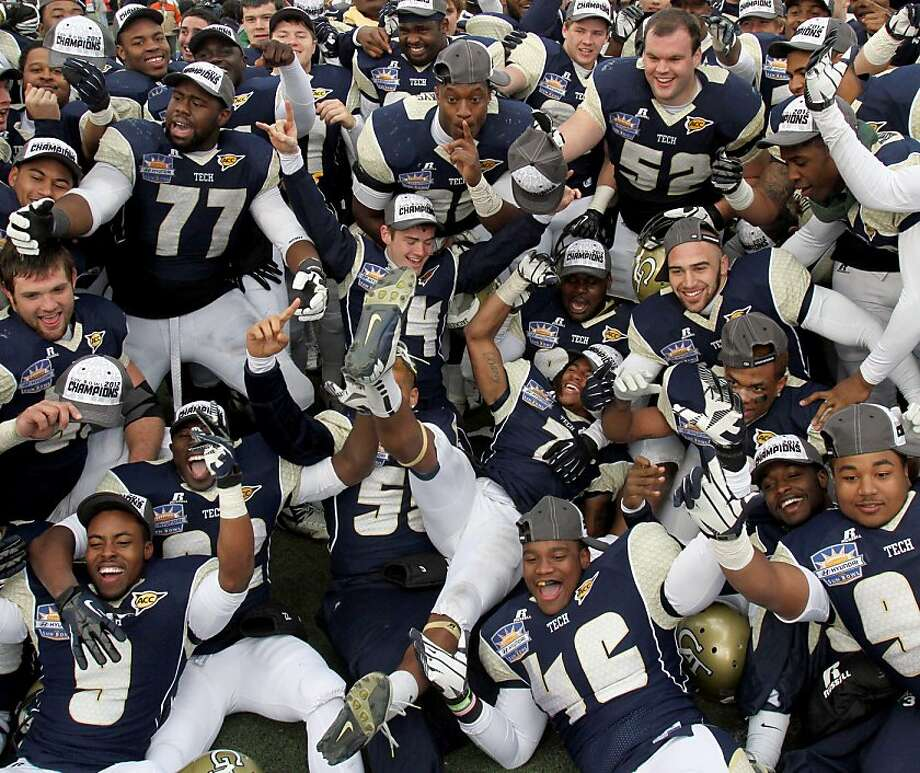 Georgia Tech players climb all over each other as they celebrate their Sun Bowl victory over USC. Photo: Victor Calzada, Associated Press