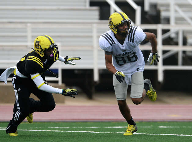 U.S. Army All-American Bowl West Team WR Corey Robinson (88) from San Antonio Christian in San Antonio, TX runs a slant route in front of U.S. Army All-American Bowl West Team DB Chris Hawkins (3) from Rancho Cucamonga High School in Fontana, CA during a U.S. Army All-American Bowl West Team practice at Comalander Stadium, Monday, December 31, 2012.  John Albright / Special to the Express-News. Photo: JOHN ALBRIGHT, Express-News / San Antonio Express-News