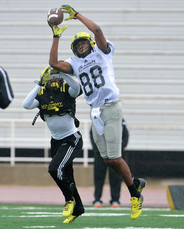 U.S. Army All-American Bowl West Team WR Corey Robinson (88) from San Antonio Christian in San Antonio, TX catches a pass in front of U.S. Army All-American Bowl West Team DB Chris Hawkins (3) from Rancho Cucamonga High School in Fontana, CA during a U.S. Army All-American Bowl West Team practice at Comalander Stadium, Monday, December 31, 2012.  John Albright / Special to the Express-News. Photo: JOHN ALBRIGHT, Express-News / San Antonio Express-News