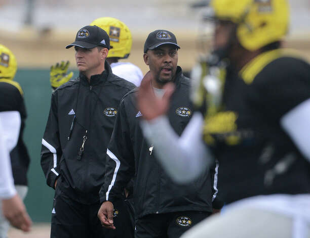 U.S. Army All-American Bowl West Team assistant coach Scott Lehnhoff (left) and head coach Mike Jinks (right) watch as players run drills during a U.S. Army All-American Bowl West Team practice at Comalander Stadium, Monday, December 31, 2012. 