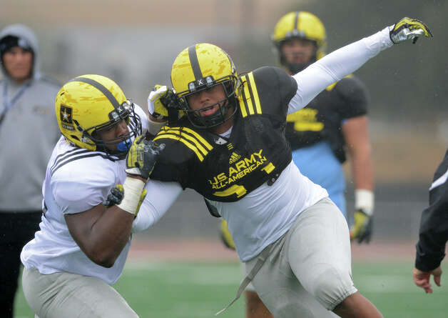 U.S. Army All-American Bowl West Team DL Joe Mathis (31) from Upland High School in Ontario, CA works his way around U.S. Army All-American Bowl West Team OL Kent Perkins (76) from Lake Highlands High School in Dallas, TX during one-on-one lineman drills during a U.S. Army All-American Bowl West Team practice at Comalander Stadium, Monday, December 31, 2012.  John Albright / Special to the Express-News. Photo: JOHN ALBRIGHT, Express-News / San Antonio Express-News