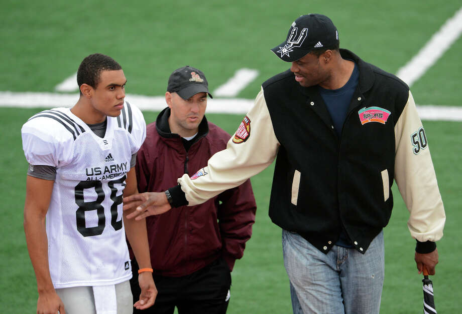U.S. Army All-American Bowl West Team WR Corey Robinson (88) from San Antonio Christian in San Antonio, TX is greated by his father former NBA player David Robinson (right) and San Antonio Christian Schools offensive coordinator Brandon Parrott (center) as he comes off the field after a U.S. Army All-American Bowl West Team practice at Comalander Stadium, Monday, December 31, 2012.  John Albright / Special to the Express-News. Photo: JOHN ALBRIGHT, Express-News / San Antonio Express-News