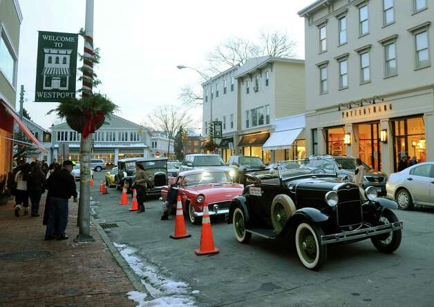 A parade of classic cars is parked on Main Street in downtown Westport as part of First Night activities on Monday, December 31, 2012. Photo: Brian A. Pounds, Connecticut Post / Connecticut Post