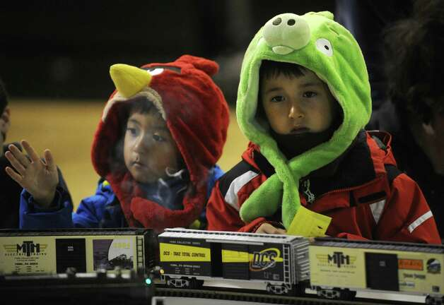 Brothers Derek, 4, left, and Devon Denkin, 7, of Westport, check out the model train display during First Night activities at the YMCA in downtown Westport on Monday, December 31, 2012. Photo: Brian A. Pounds, Connecticut Post / Connecticut Post
