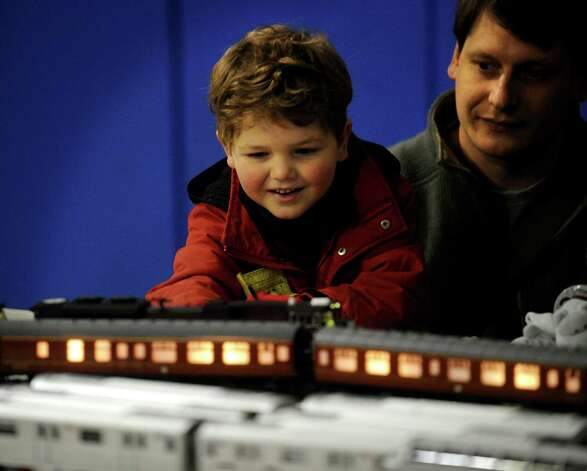 Jay Cucinel, 4, and his father Glenn, of Westport, check out a model train display during First Night activities at the YMCA in downtown Westport on Monday, December 31, 2012. Photo: Brian A. Pounds, Connecticut Post / Connecticut Post