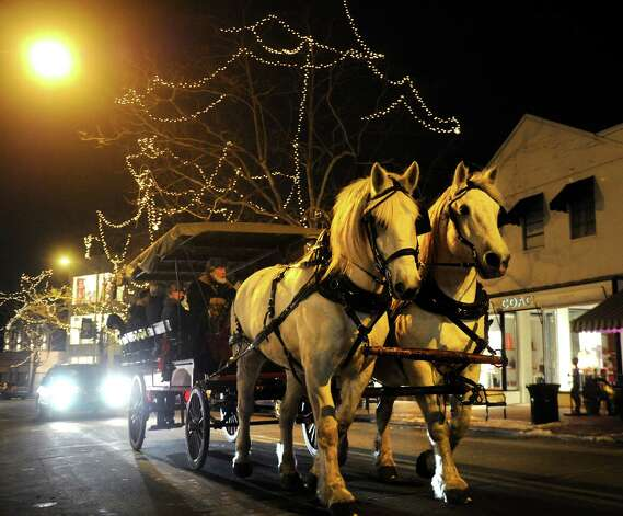 A horse drawn carraige heads up Main Street in downtown Westport as part of First Night festivities on Monday, December 31, 2012. Photo: Brian A. Pounds, Connecticut Post / Connecticut Post