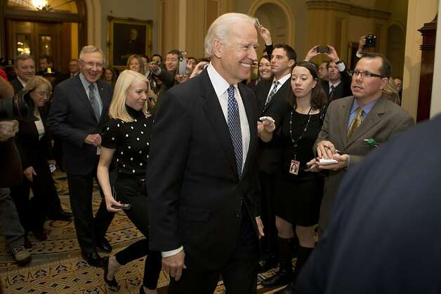 U.S. Vice President Joe Biden arrives to a Democratic caucus meeting with Senator Harry Reid, a Democrat from Nevada, left, at the U.S. Capitol in Washington, D.C., U.S., on Monday, Dec. 31, 2012. Biden arrived at the Capitol to present a budget deal to wavering Democrats, in advance of a possible vote by 10:30 p.m. tonight, with tax increases for almost every U.S. worker set to start tomorrow. Photographer: Andrew Harrer/Bloomberg *** Local Caption *** Joe Biden; Harry Reid Photo: Andrew Harrer, Bloomberg