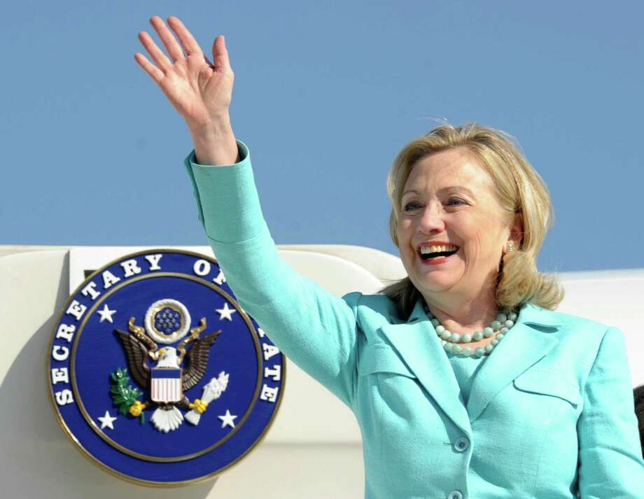 FILE - In this June 10, 2011 file photo, Secretary of State Hillary Rodham Clinton waves as the arrives at Lusaka International Airport in Lusaka, Zambia. Clinton has been admitted to a New York hospital after the discovery of a blood clot stemming from the concussion she sustained earlier this month. Spokesman Philippe Reines says her doctors discovered the clot during a follow-up exam Sunday, Dec. 30, 2012. (AP Photo/Susan Walsh, Pool, File) Photo: Susan Walsh