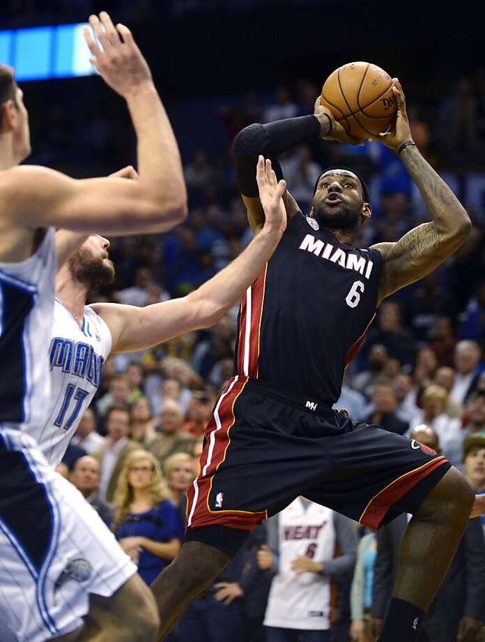 LeBron James scored eight points in overtime as Miami avoided its first three-game skid this season. Photo: Phelan M. Ebenhack, Associated Press