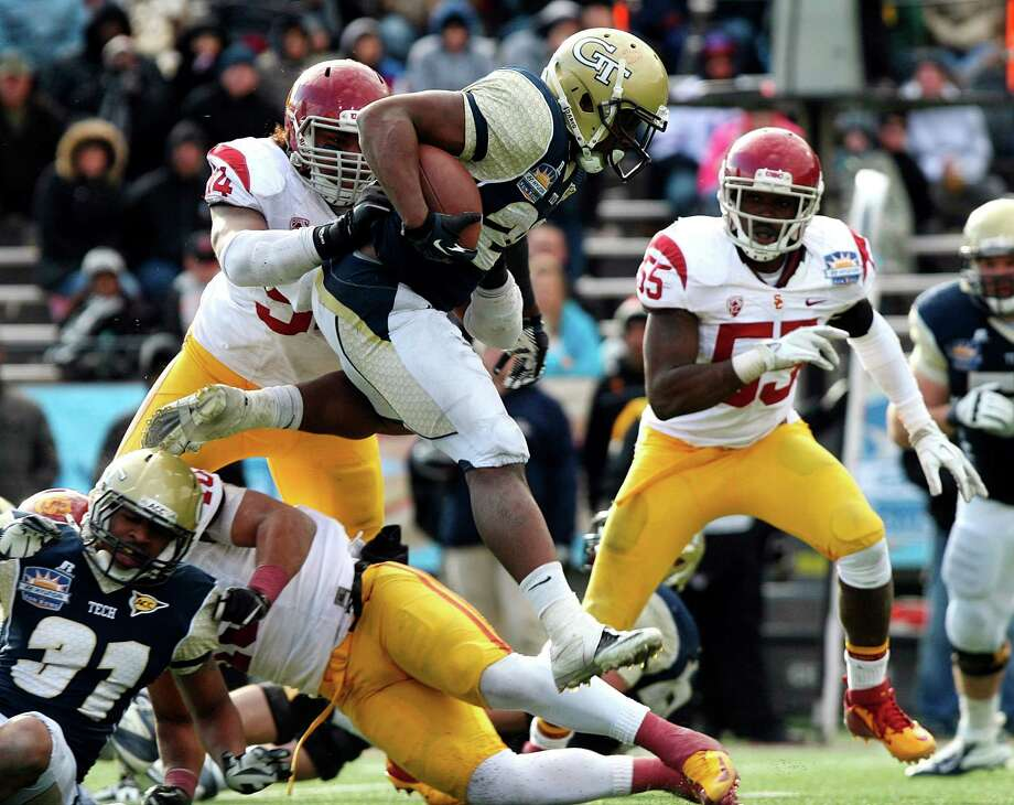 Hyundai Sun Bowl, Dec. 31: Georgia Tech 21, Southern California 7; Sun Bowl in El Paso, Texas; Payout: $2,000,000PHOTO: Georgia Tech running back David Sims leaps over a pile up of Southern California defenders during the Sun Bowl. Photo: Mark Lambie, Associated Press / FR104326 AP