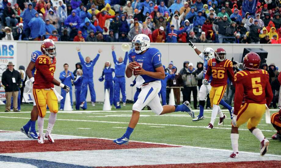 AutoZone Liberty Bowl, Dec. 31: Tulsa 31, Iowa State 17; Liberty Bowl in Memphis, Tenn.; Payout: $1,437,000; ESPNPHOTO: Tulsa quarterback Cody Green (7) sprints into the end zone with a 7-yard second-quarter touchdown run against Iowa State in the Liberty Bowl. Photo: Rogelio V. Solis, Associated Press / AP