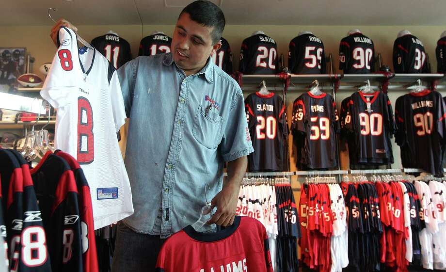 Pedro Rodriguez shops for Houston Texan merchandise at the Go Texans Store in Reliant Stadium Tuesday, Sept. 21, 2010, in Houston. ( James Nielsen / Houston Chronicle ) Photo: James Nielsen, Staff / Houston Chronicle