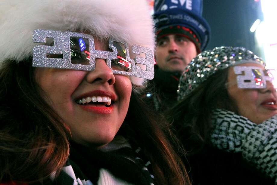 Alexandra Esquivel, left, and her aunt Anna Ramos, right, both from Arizona, attend the New Year's Eve festivities in New York's Times Square on Monday, Dec. 31, 2012. (AP Photo/Tina Fineberg) Photo: Tina Fineberg, Associated Press