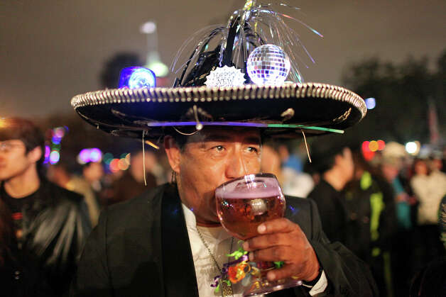 Frank Sanchez drinks a beer during the Celebrate San Antonio event held Monday Dec. 31, 2012. Photo: Edward A. Ornelas, San Antonio Express-News / © 2012 San Antonio Express-News