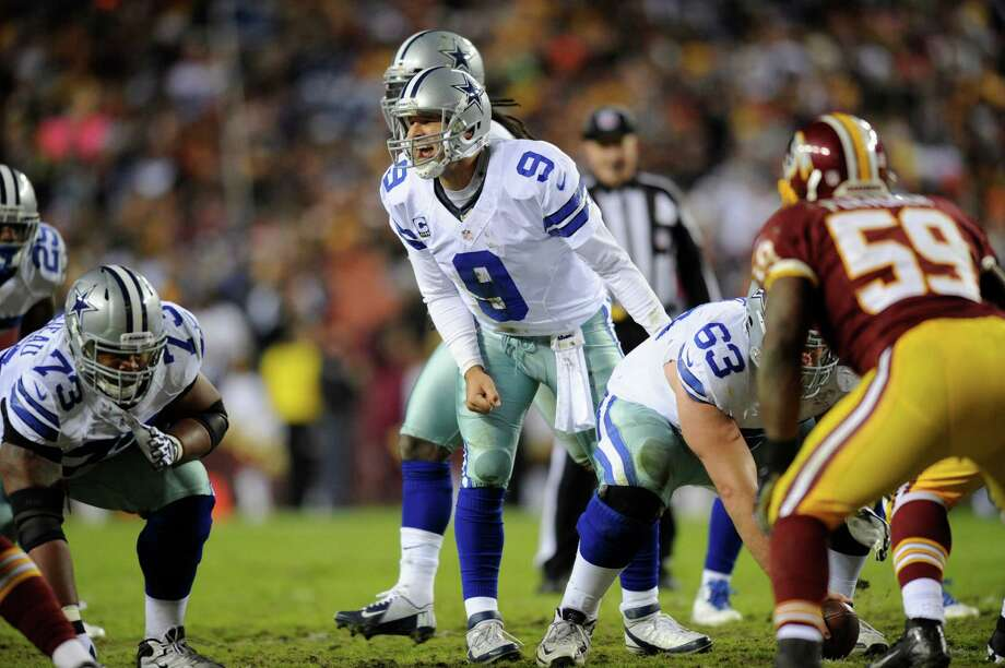 Cowboys quarterback Tony Romo had three interceptions in the season-ending loss to Washington. Photo: Nick Wass, FRE / FR67404 AP