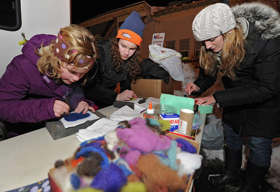 From left, Kailie Nolan, 11, of Durham, Sara Stiverson, 13, of Catskill and Chelsea Bordonaro from Boston try their hand at needle felting with Alpaca fiber from Breezy Hill Ranch during First Night Saratoga on Monday Dec. 31, 2012 in Saratoga Springs, N.Y. (Lori Van Buren / Times Union) Photo: Lori Van Buren