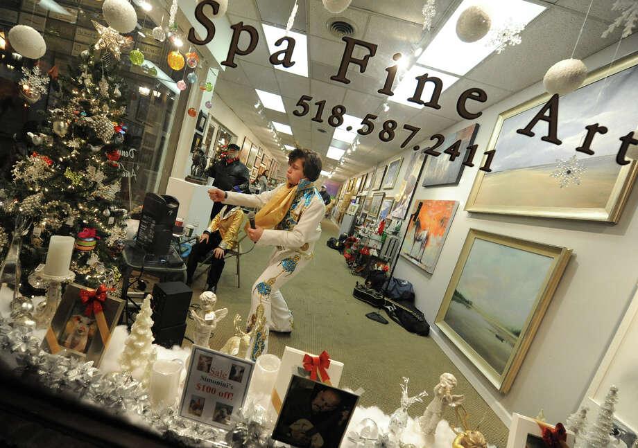 Matthew Boyce, 13, of Saratoga Springs impersonates Elvis in a storefront window during First Night Saratoga on Monday Dec. 31, 2012 in Saratoga Springs, N.Y. (Lori Van Buren / Times Union) Photo: Lori Van Buren