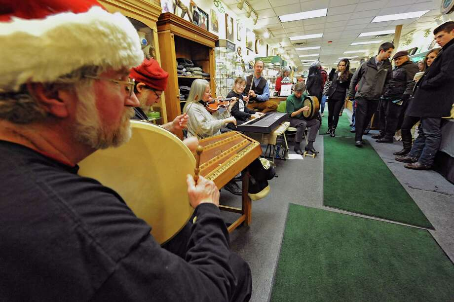 Different musicians that play at the Pan-Celtic Sessions at the Parting Glass on Wednesdays play at Celtic Treasures store during First Night Saratoga on Monday Dec. 31, 2012 in Saratoga Springs, N.Y. (Lori Van Buren / Times Union) Photo: Lori Van Buren