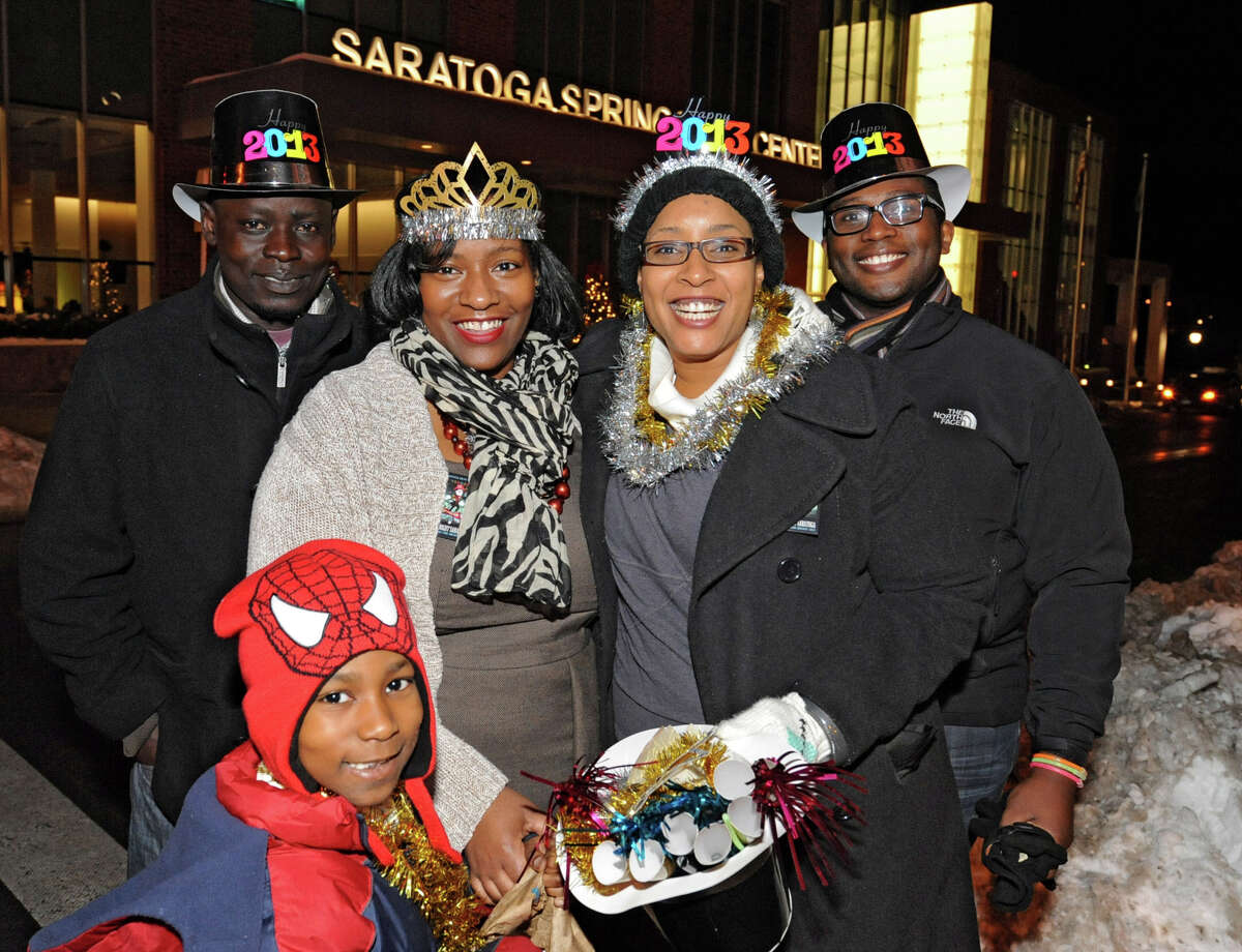 From left, Francis Andrew, Nicolas Andrew, 7, Lekeya Andrews, Jamey Martin and Charlie Fields, all of Albany, celebrate New Years Eve at First Night Saratoga on Monday Dec. 31, 2012 in Saratoga Springs, N.Y. (Lori Van Buren / Times Union)
