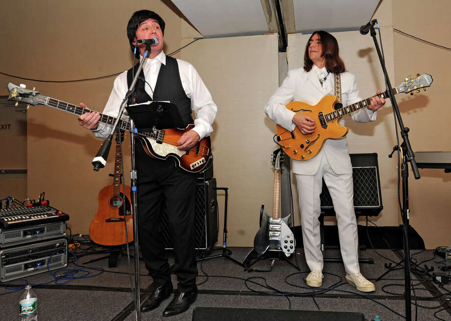 Imagining Lennon and McCartney play to a crowd at the Saratoga Hilton Broadway during First Night Saratoga on Monday Dec. 31, 2012 in Saratoga Springs, N.Y. (Lori Van Buren / Times Union) Photo: Lori Van Buren