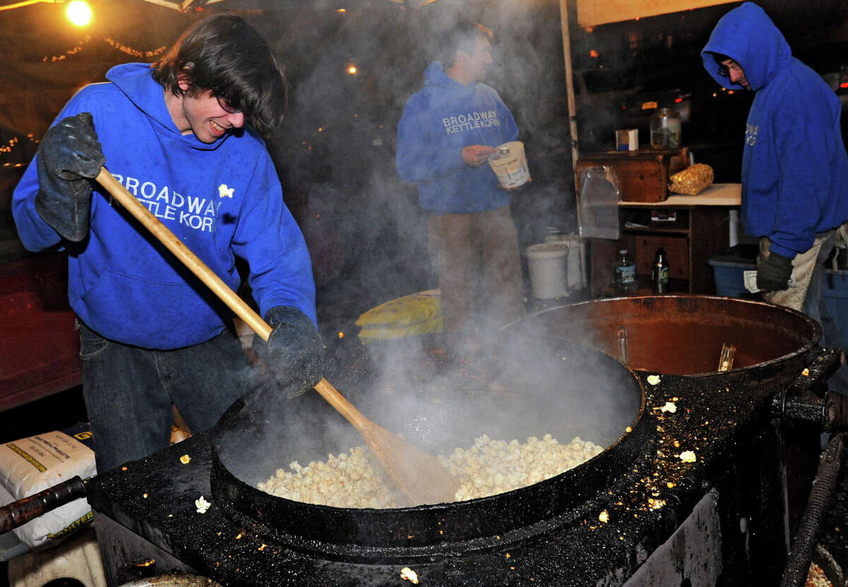 Jesse Muse of Saratoga stirs the kettle corn for the company Broadway Kettle Korn during First Night Saratoga on Monday Dec. 31, 2012 in Saratoga Springs, N.Y. (Lori Van Buren / Times Union)