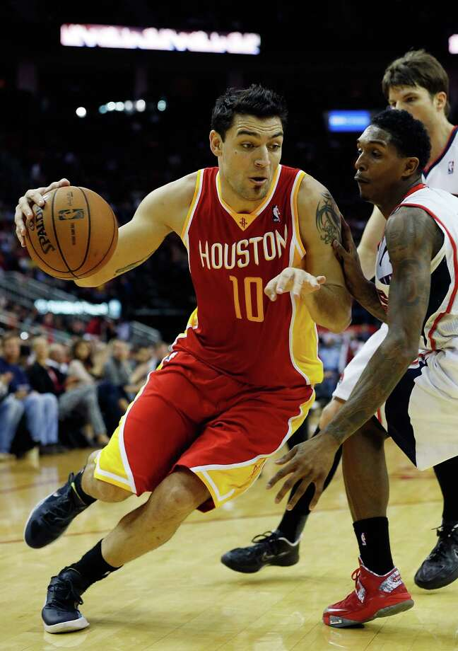 The Rockets' Carlos Delfino had enough offensive tenacity to score a season-high 22 points Monday night. Photo: Scott Halleran, Staff / 2012 Getty Images