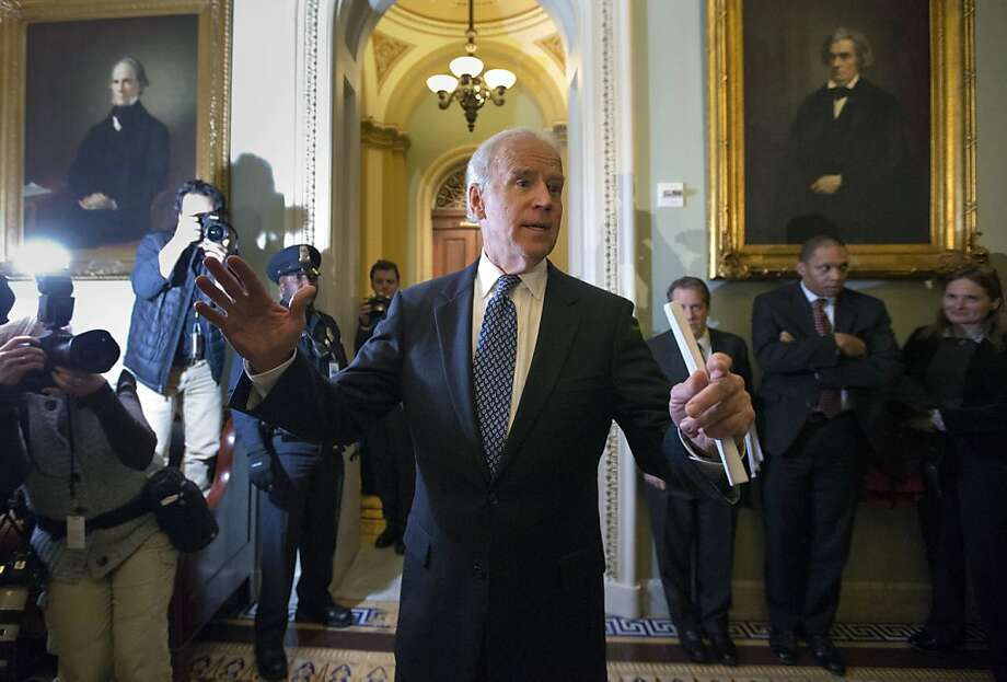 Vice President Joe Biden outlines the compromise agreement for reporters after meeting with Senate Democrats. Photo: Alex Brandon, Associated Press