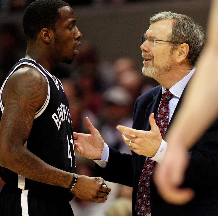 Nets coach P.J. Carlisimo talks with Tyshawn Taylor during the second half at the AT&T Center, Monday, Dec. 31, 2012. The San Antonio Spurs won 104-73. Photo: Jerry Lara, San Antonio Express-News / © 2012 San Antonio Express-News