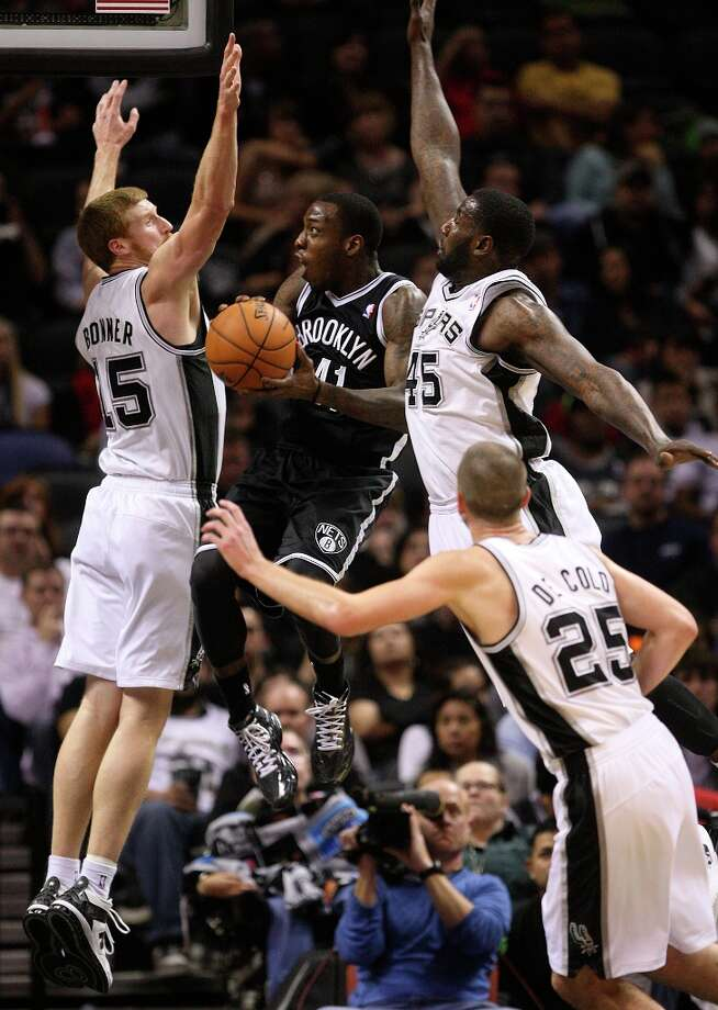 The Spurs' Matt Bonner and DeJuan Blair defend against the Nets' Tyshawn Taylor during the second half at the AT&T Center, Monday, Dec. 31, 2012. The Spurs won 104-73. Photo: Jerry Lara, San Antonio Express-News / © 2012 San Antonio Express-News