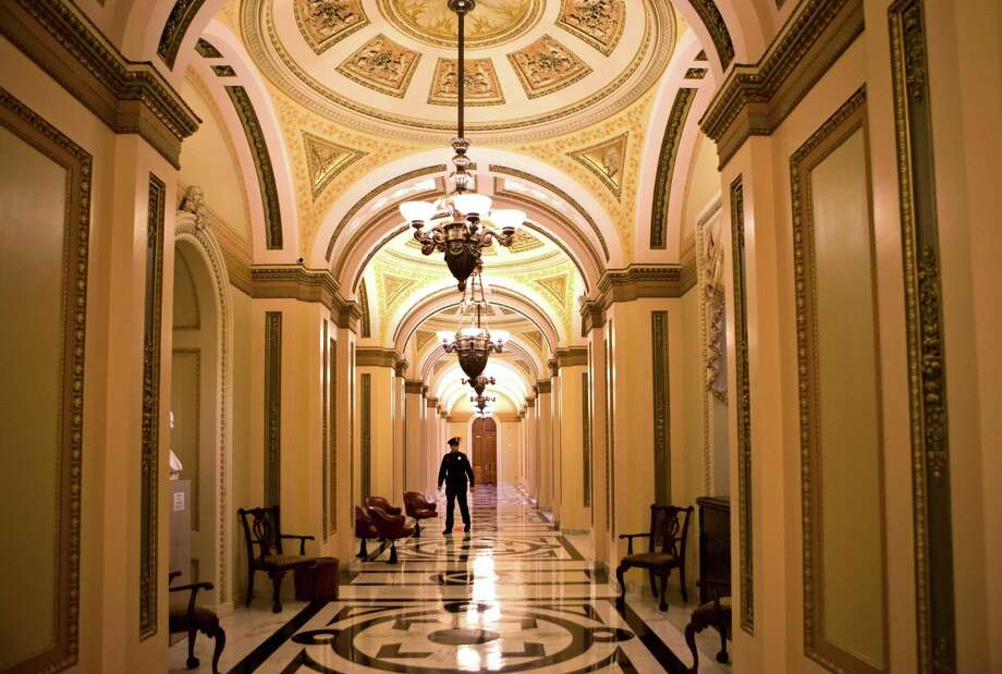 The corridor that leads to the floor of the House of Representatives was empty late Monday after the chamber's leadership decided to recess without voting. Photo: J. Scott Applewhite, STF / AP