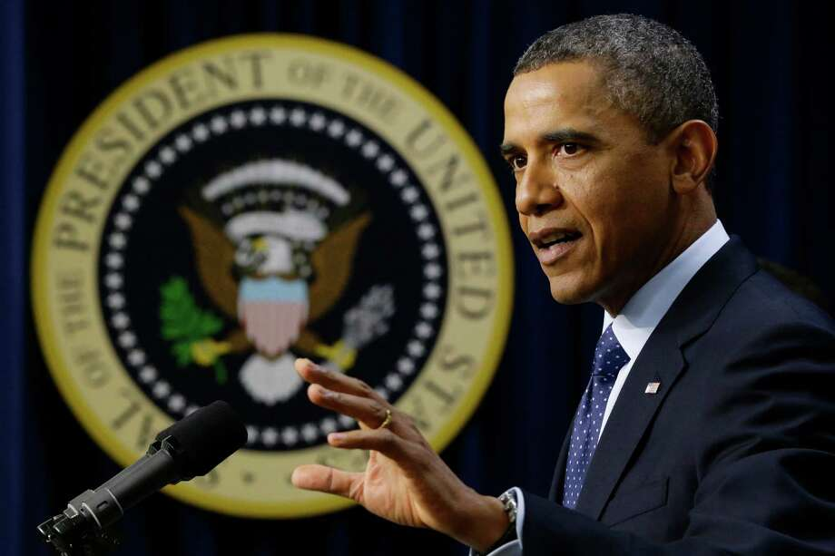 "President Barack Obama gestures as he speaks about the fiscal cliff, Monday, Dec. 31, 2012, in the South Court Auditorium at the White House in Washington. The president said it appears that an agreement to avoid the fiscal cliff is ""in sight,"" but says it's not yet complete and work continues.  (AP Photo/Charles Dharapak) Photo: Charles Dharapak"